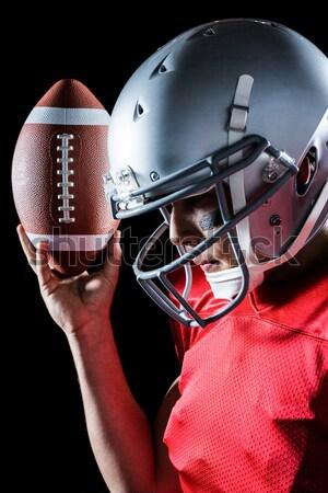 Amerikai futballista tart labda fej viselet Stock fotó © wavebreak_media