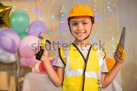 Boy pretending as a worker during birthday party Stock photo © wavebreak_media