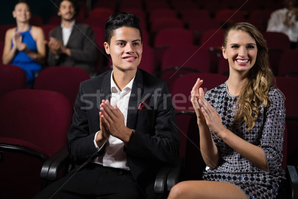 Couple applauding while watching movie in theatre Stock photo © wavebreak_media