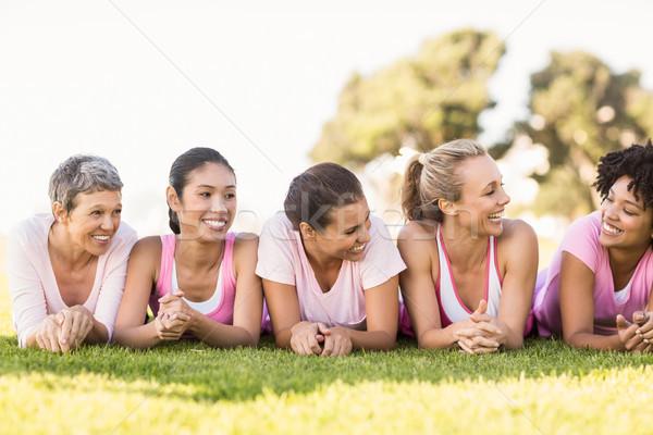 Sorridere donne fila indossare rosa Foto d'archivio © wavebreak_media