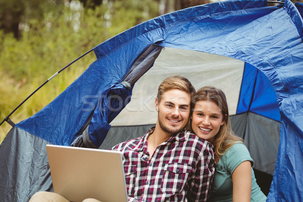 Young pretty hiker couple sitting in a tent looking at camera Stock photo © wavebreak_media