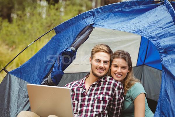 молодые довольно турист пару сидят палатки Сток-фото © wavebreak_media