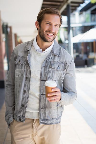 Genç mutlu gülen adam fincan Stok fotoğraf © wavebreak_media