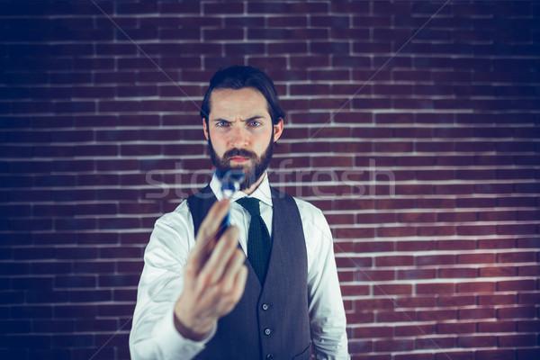 Sérieux homme rasoir mur de briques soins Photo stock © wavebreak_media