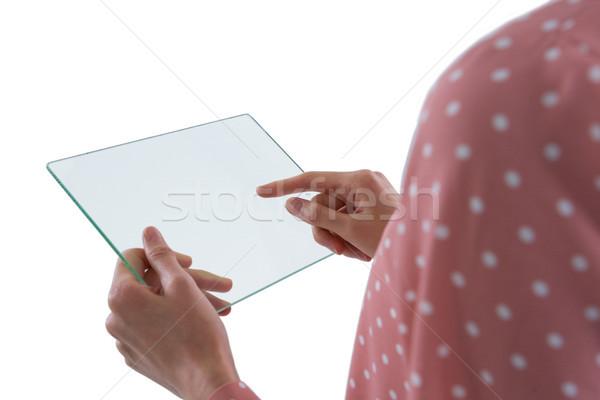 Woman using glass digital tablet Stock photo © wavebreak_media