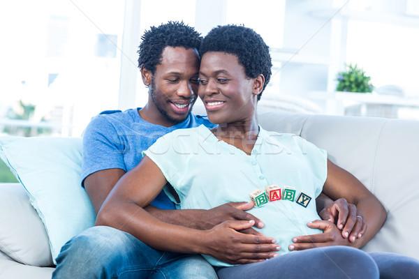 Felice donna incinta marito toccare pancia rilassante Foto d'archivio © wavebreak_media