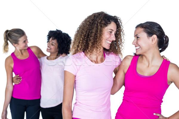 Happy women with arms around  Stock photo © wavebreak_media
