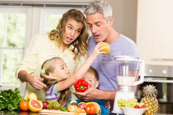 Happy family preparing healthy smoothie Stock photo © wavebreak_media