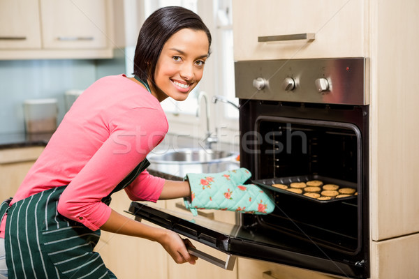 Smiling woman baking biscuits Stock photo © wavebreak_media
