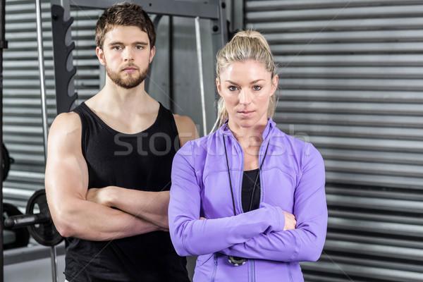 S'adapter couple bras crossfit gymnase homme Photo stock © wavebreak_media