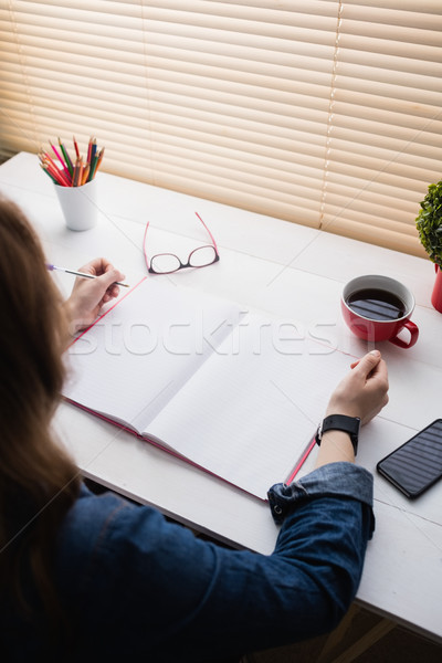 Casual businesswoman working at her desk Stock photo © wavebreak_media