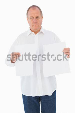Stern man holding ripped paper Stock photo © wavebreak_media