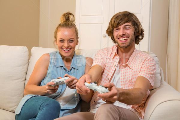 Cute Paar spielen Videospiele Sitzung Couch Stock foto © wavebreak_media