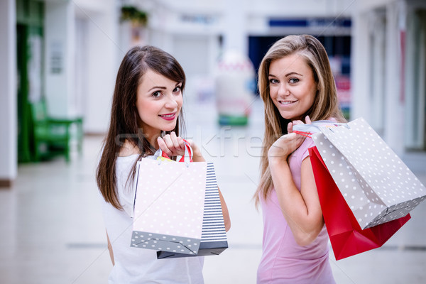 Portrait of two beautiful women shopping in mall Stock photo © wavebreak_media