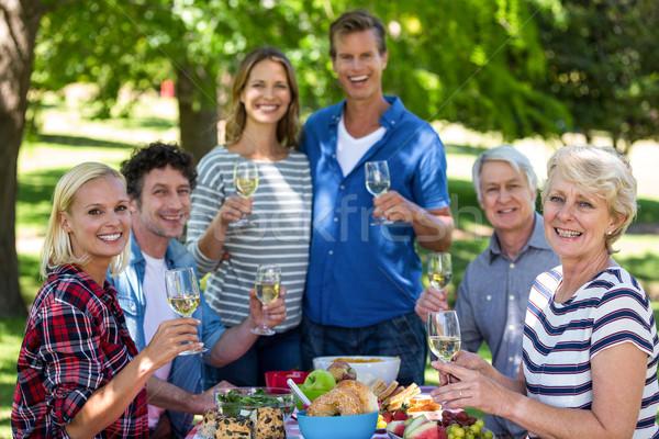 Barátok piknik bor park nő fű Stock fotó © wavebreak_media