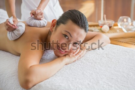 Pretty woman smiling while receiving spa treatment Stock photo © wavebreak_media