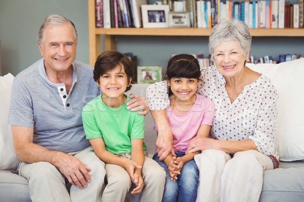 Feliz netos avós sessão casa sofá Foto stock © wavebreak_media