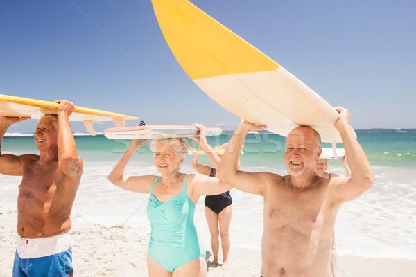 Senior amigos prancha de surfe praia mulher Foto stock © wavebreak_media