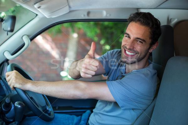 Portrait of happy man showing thumbs up Stock photo © wavebreak_media