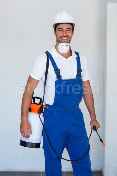 Portrait of happy manual worker with insecticide Stock photo © wavebreak_media