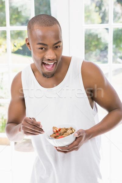 Retrato joven desayuno cereales casa negro Foto stock © wavebreak_media