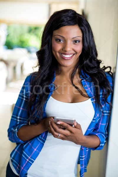 Young woman holding mobile Stock photo © wavebreak_media