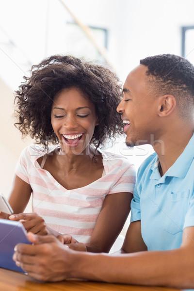 Feliz casal telefone móvel digital comprimido casa Foto stock © wavebreak_media