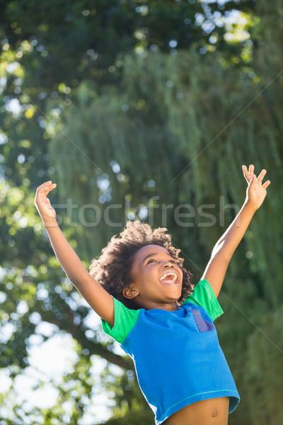 Boy is raising his arms Stock photo © wavebreak_media