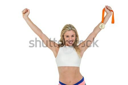 Atléta pózol aranyérem győzelem fehér boldog Stock fotó © wavebreak_media