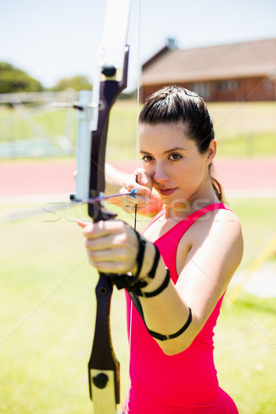 Kadın atlet okçuluk stadyum kadın Stok fotoğraf © wavebreak_media