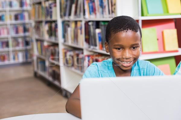 男子生徒 ラップトップを使用して ライブラリ 学校 コンピュータ 教育 ストックフォト © wavebreak_media