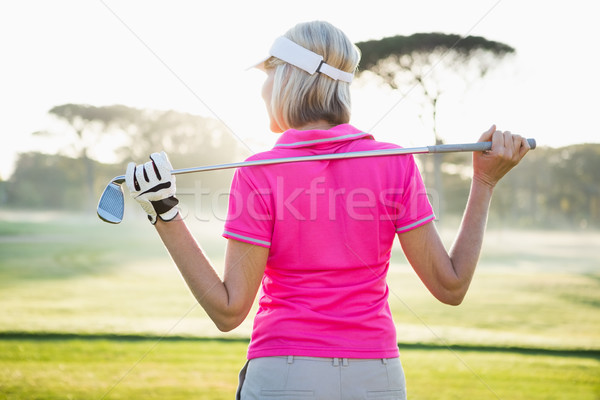 Rear view of woman golfer holding her club Stock photo © wavebreak_media