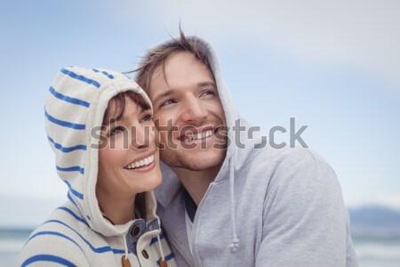 Mid adult romantic couple embracing against white background Stock photo © wavebreak_media
