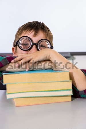 Portrait of schoolkid pretending to be a teacher in classroom Stock photo © wavebreak_media
