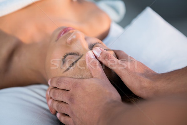Woman receiving head massage from physiotherapist Stock photo © wavebreak_media