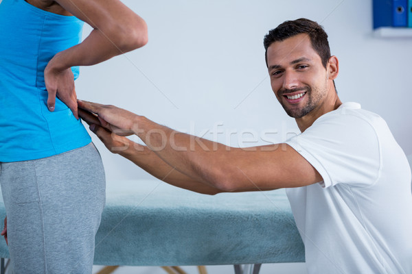 Physiotherapist examining womans back  Stock photo © wavebreak_media