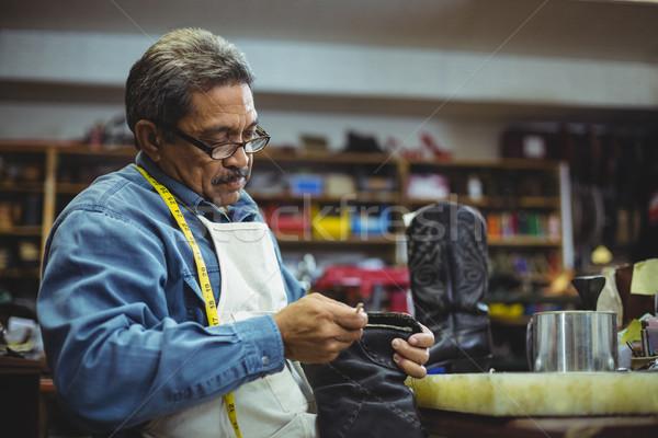 Shoemaker applying glue on shoe Stock photo © wavebreak_media