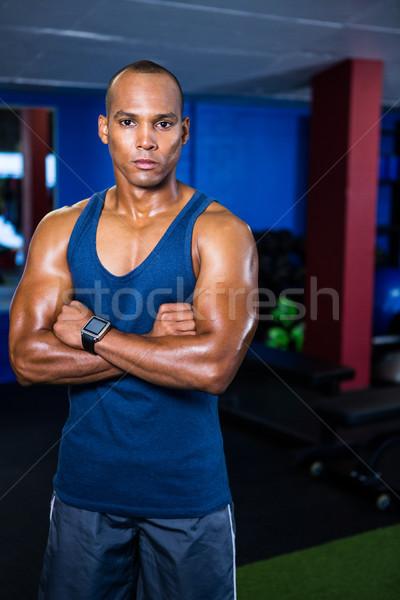 Atléta áll tornaterem portré keresztbe tett kar sport Stock fotó © wavebreak_media