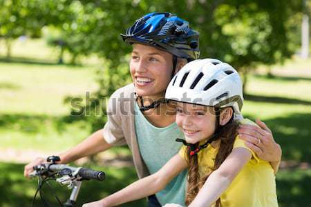 Female athletic leaning on bicycle in countryside Stock photo © wavebreak_media