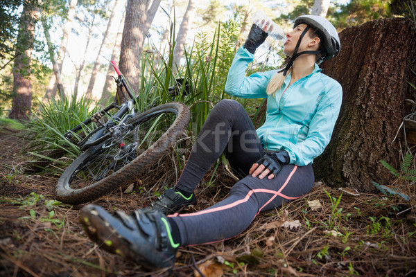 Female mountain biker drinking water Stock photo © wavebreak_media