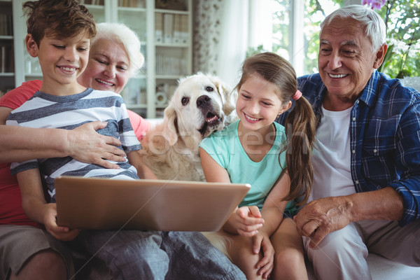 Grandparents and grandchildren using laptop in living room Stock photo © wavebreak_media