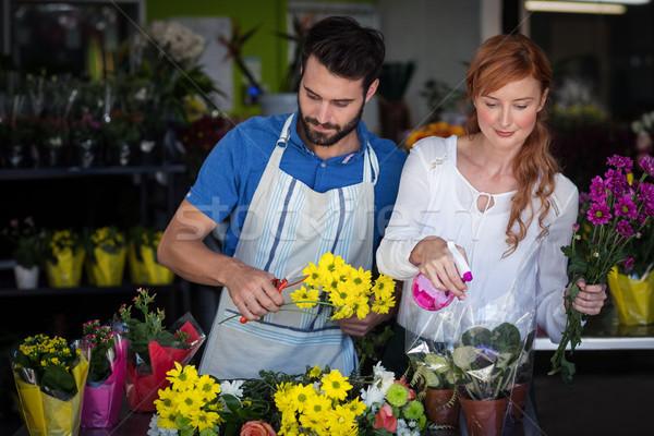 Couple preparing flower bouquet Stock photo © wavebreak_media