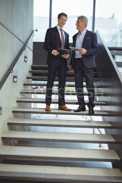 Business executives having a conversation on stairs Stock photo © wavebreak_media