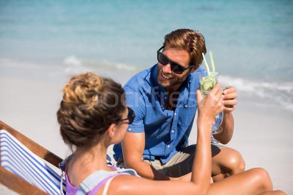 Couple having drinks on shore at beach Stock photo © wavebreak_media