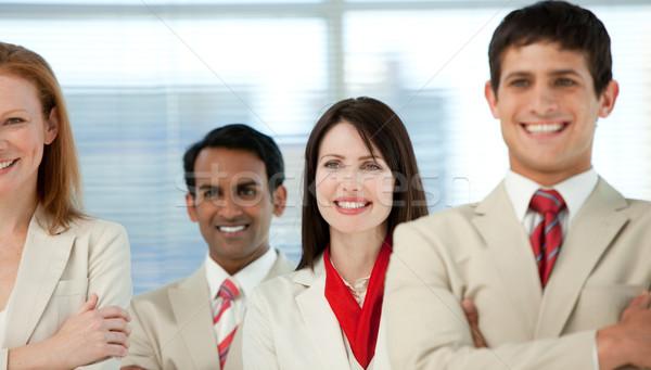 Primer plano negocios internacionales personas doblado armas negocios Foto stock © wavebreak_media