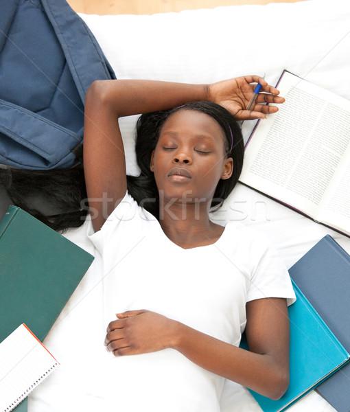 Stanco studente compiti per casa letto home donna Foto d'archivio © wavebreak_media