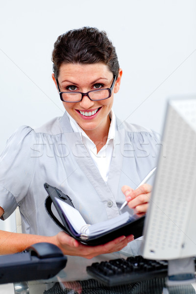 野心的な ビジネス女性 議題 オフィス 手 ペン ストックフォト © wavebreak_media
