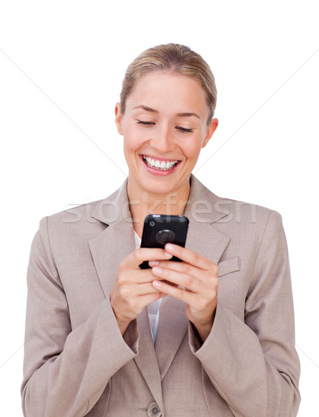 Elegant businesswoman sending a text  Stock photo © wavebreak_media