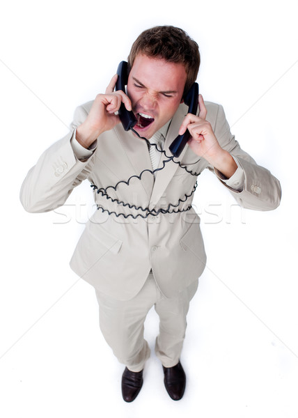Furious businessman tangle up in phone wires Stock photo © wavebreak_media