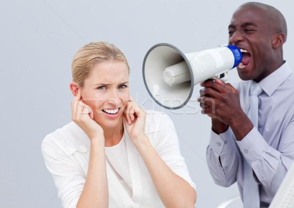 Angry businessman shouting through a megaphone Stock photo © wavebreak_media